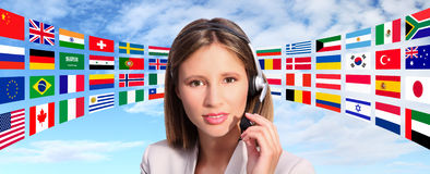 Call center operator international contact. On flags background Royalty Free Stock Images