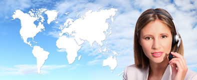 Call center operator international contact. On global map  sky background Stock Images