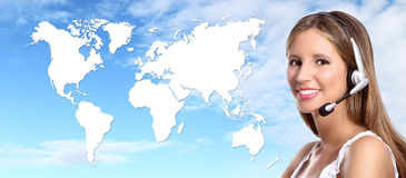 Call center operator international contact. Headset and global map Royalty Free Stock Photos