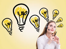 Call center operator lightbulbs Royalty Free Stock Photography