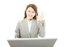 Call center operator making ok sign Royalty Free Stock Photography