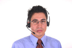 Call center operator-male. Man working as a call center operator Royalty Free Stock Photos