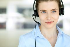 Call center operator. Portrait of beautiful business woman in headset stock photo