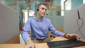 Call center operator providing the client with all the necessary information concerning a product or service, stock video footage