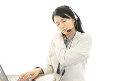 Call center operator with shoulder pain. Royalty Free Stock Photo