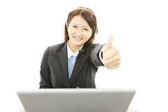 Call center operator showing thumbs up sign Stock Photography