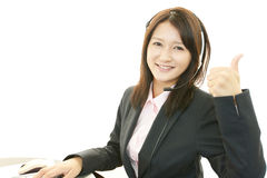 Call center operator showing thumbs up sign Royalty Free Stock Photos
