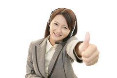 Call center operator showing thumbs up sign stock image