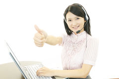 Call center operator showing thumbs up sign Stock Photos