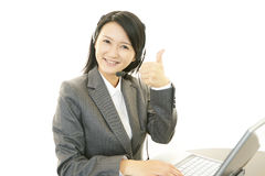 Call center operator showing thumbs up sign Royalty Free Stock Images