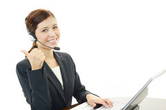Call center operator showing thumbs up sign Stock Images