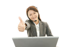 Call center operator showing thumbs up sign Royalty Free Stock Image