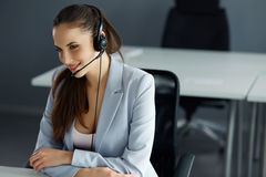 Call Center Operator Sitting Infront of Her Computer Stock Image