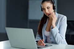 Call Center Operator Sitting Infront of Her Computer Royalty Free Stock Photos