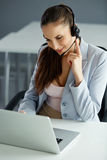 Call Center Operator Sitting Infront of Her Computer Royalty Free Stock Photo