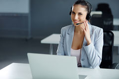 Call Center Operator Sitting Infront of Her Computer Stock Images