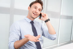 Call center operator talking on mobile phone Stock Image