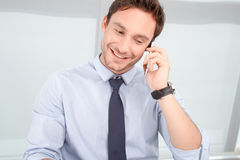Call center operator talking on mobile phone Royalty Free Stock Photos