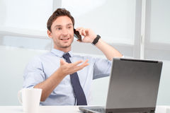 Call center operator talking on mobile phone Royalty Free Stock Images