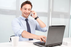 Call center operator talking on mobile phone Royalty Free Stock Photography