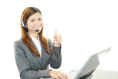 The call center operator who poses happily Stock Photo