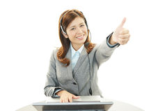 The call center operator who poses happily Royalty Free Stock Photo