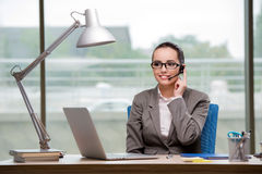 The call center operator working at her desk Royalty Free Stock Images