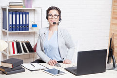 Call Center operator works for computer headphones Royalty Free Stock Photography
