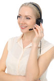 Call center operator or young beautiful business woman in headset isolated over white background Royalty Free Stock Images