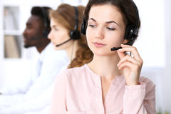 Call center operator.Young beautiful business woman in headset Royalty Free Stock Photo