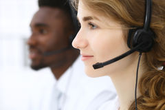 Call center operator.Young beautiful business woman in headset Royalty Free Stock Images