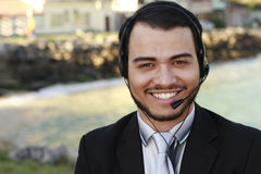 Call center operator. Young call center operator smiling Stock Photo