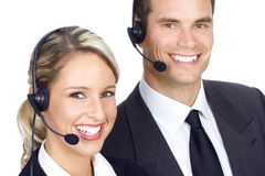 Call Center Operators. Smiling business people with headsets. Over white background stock photos