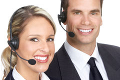 Call Center Operators. Smiling business people with headsets. Over white background stock photo