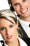 Call Center Operators. Smiling business people with headsets. Over white background stock photography