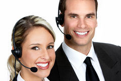 Call Center Operators. Smiling business people with headsets. Over white background royalty free stock photography
