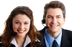 Call Center Operators. Smiling business people with headsets. Over white background royalty free stock images