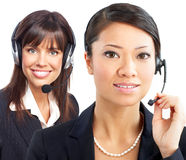 Call Center Operators. Beautiful  call center operators with headset. Over white background Stock Images