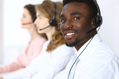 Call center operators. African american businessman in headset. Stock Photo