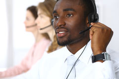 Call center operators. African american businessman in headset. Royalty Free Stock Images