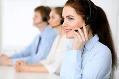 Call center operators. Focus at  business woman in headset Stock Photos