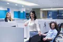 Call center operators. Group of young business people with headset working and giving support to customers in a call center office Stock Photography