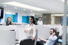 Call center operators. Group of young business people with headset working and giving support to customers in a call center office Royalty Free Stock Photo