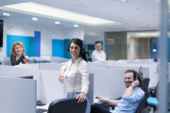 Call center operators. Group of young business people with headset working and giving support to customers in a call center office Royalty Free Stock Photography