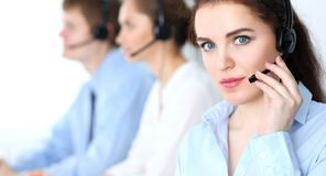 Call center operators at work. Focus at business woman in headset stock photo