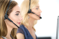 Call center operators at work. Help and support concept Stock Photos