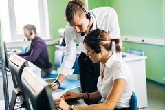 Call center operators at work. In office Royalty Free Stock Photos