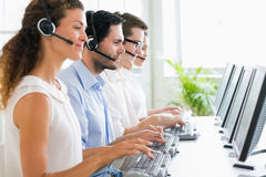 Call center operators working at desk Royalty Free Stock Photography