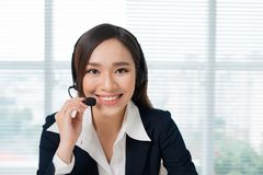 Call center operators. Young beautiful asian business woman in h. Eadset Royalty Free Stock Image