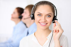 Call center operators. Young beautiful business woman in headset. Call center. Male call operator in headset at the. Call center operators. Young beautiful Royalty Free Stock Photo